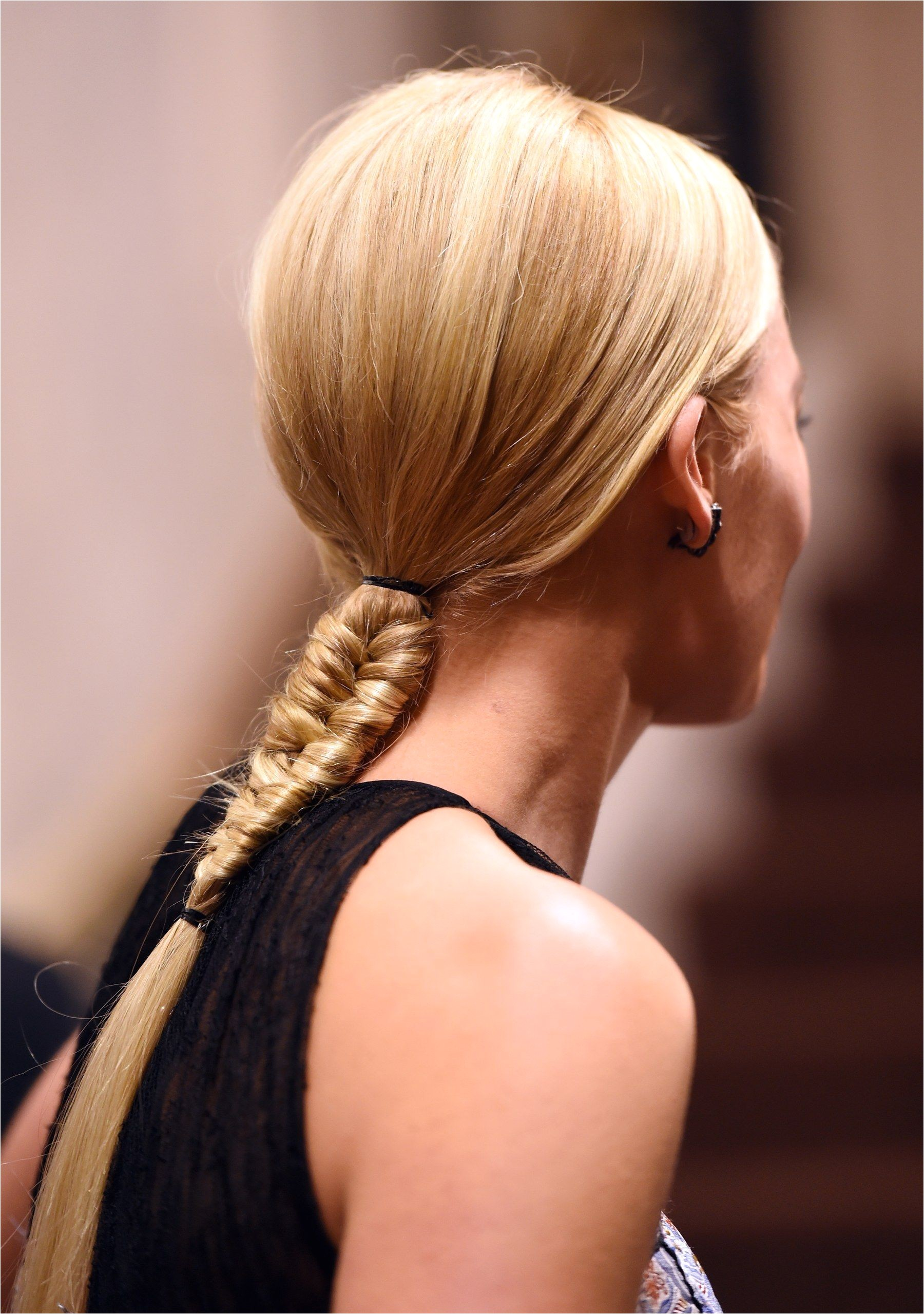 Swapping out your typical three strand braid for a fishtail braid can instantly upgrade your