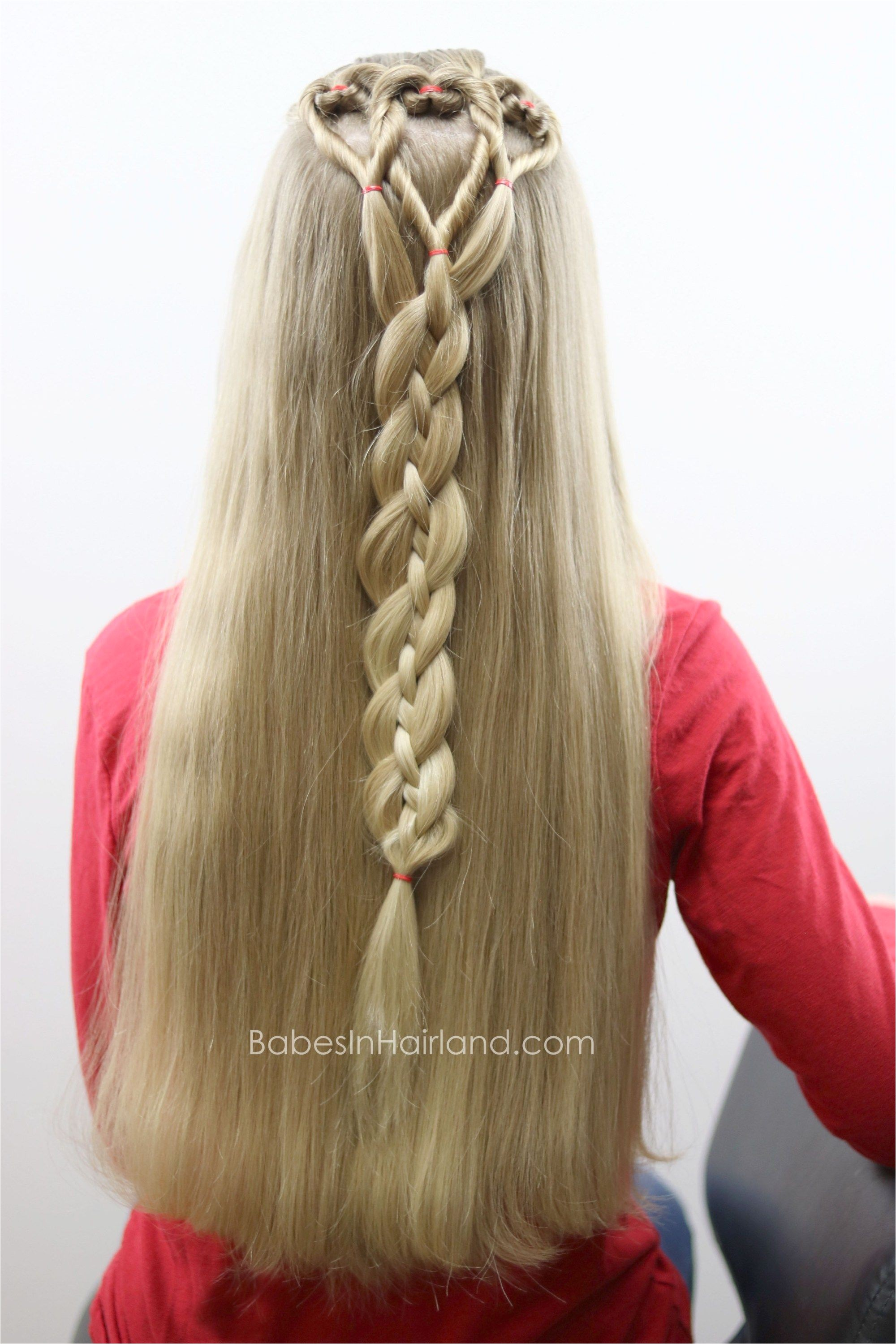 Three hearts are better than one We love this twisted heart and 4 strand braid hairstyle from BabesInHairland It s perfect for school Valentine s Day