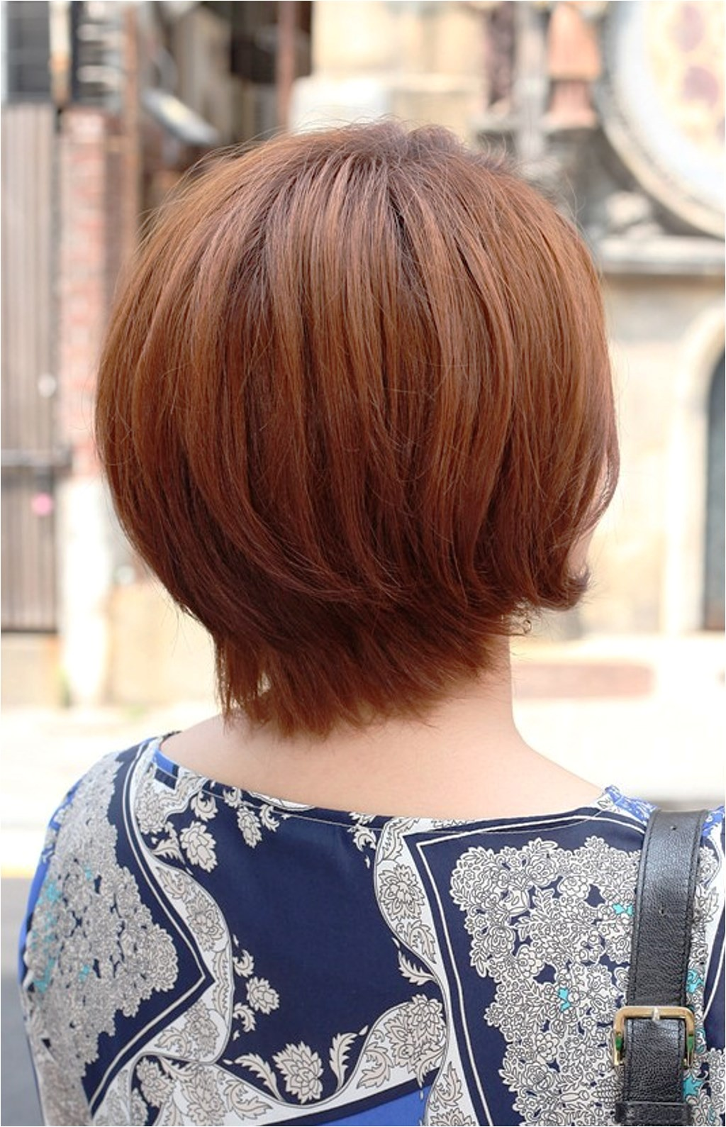 back view of short auburn bob hairstyle 2