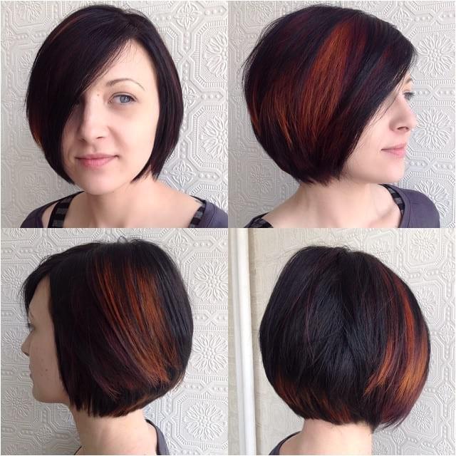 classic bob on dark hair with bright fiery peekaboo highlights