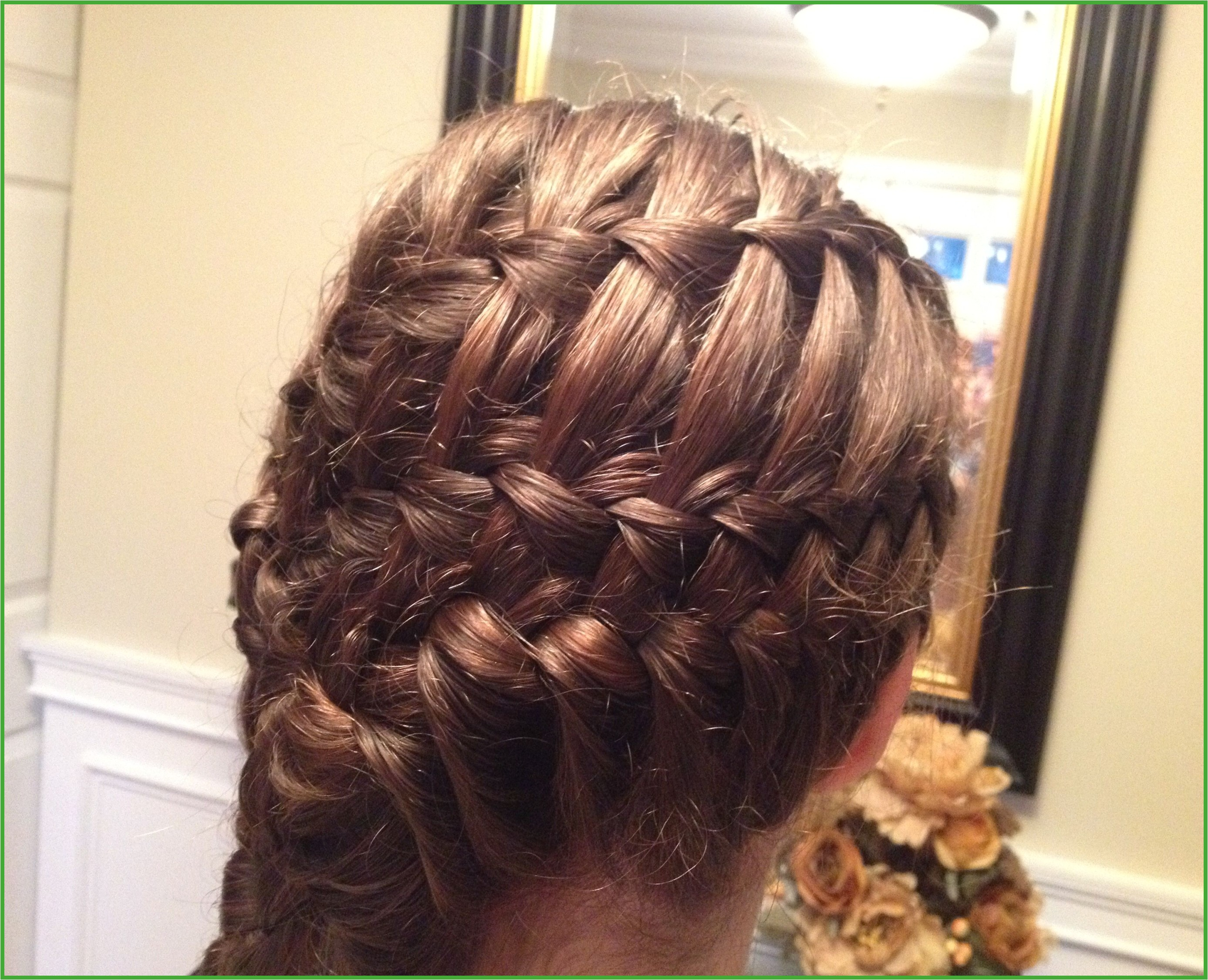 Two waterfall braids and a normal French braid at the bottom going into a five strand