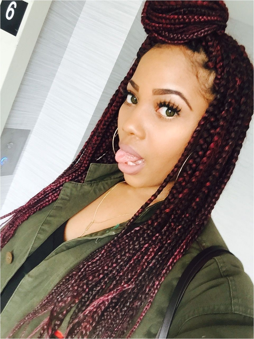 Box braids with red tones mixed