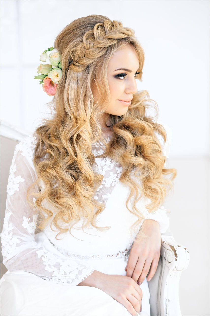 Idike to add one of the hair flowers to the top half and it d be perfect Braids and curls wedding hair inspiration via elstile