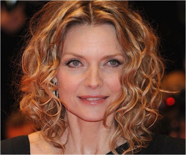 medium length curly hairstyles for women over 50