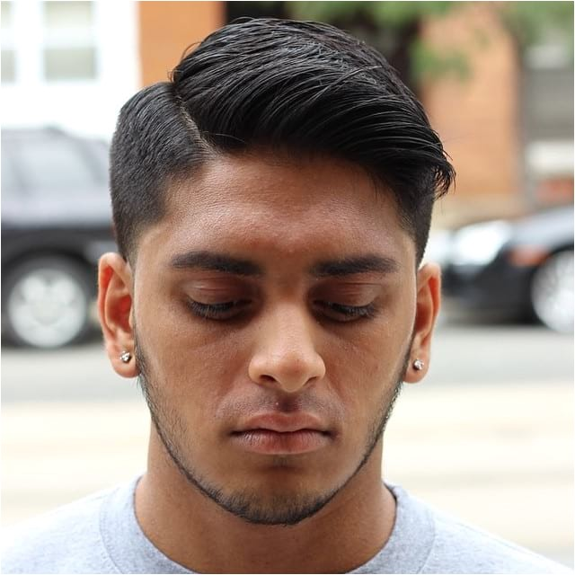 regular cut with tapered sides and side part on dark hair