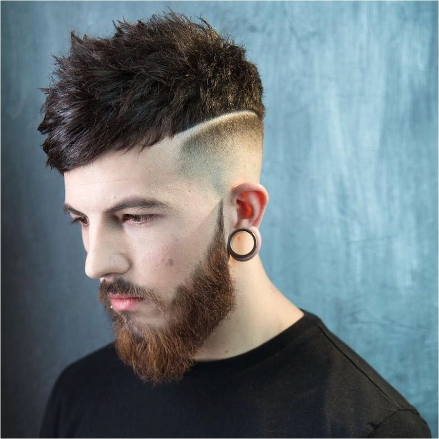undercut fade hairstyle with long bangs