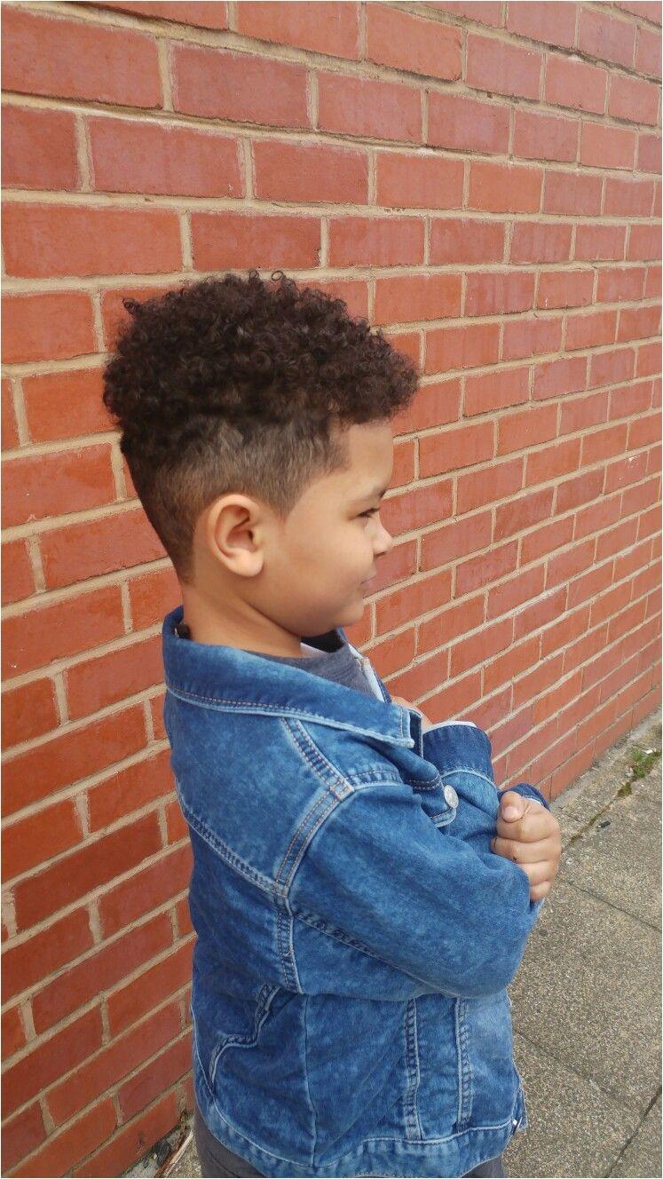 Fading high top mixed race boys hair