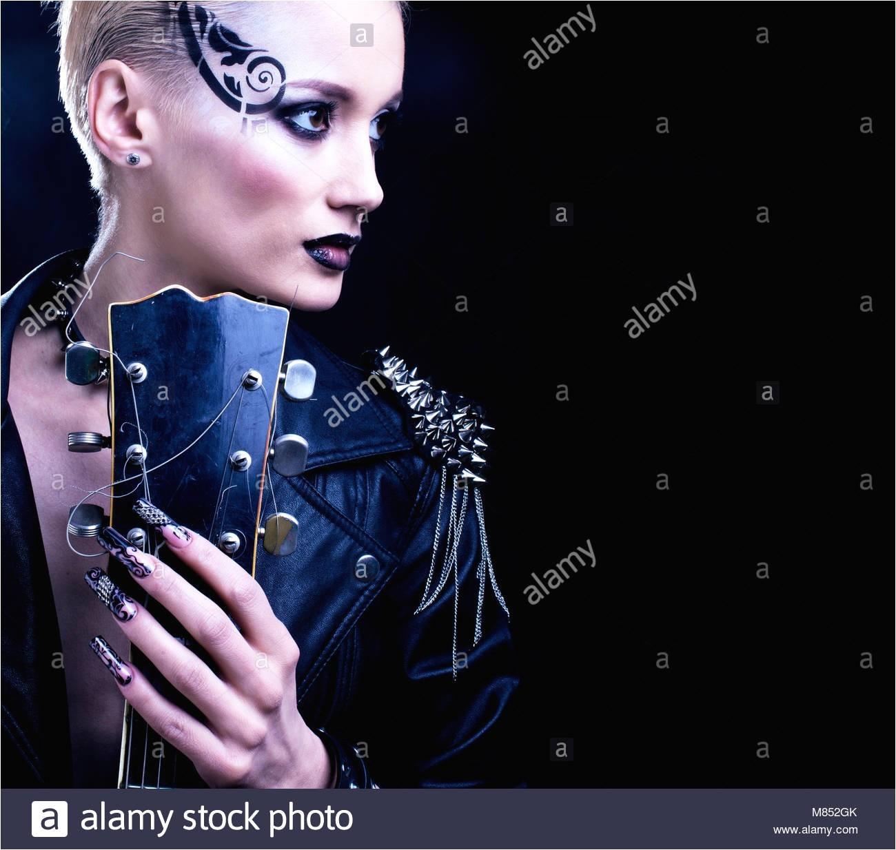 Fashion Rocker Style Model Girl Portrait Hairstyle Punk Woman Makeup Hairdo and black Nails Smoky Eyes