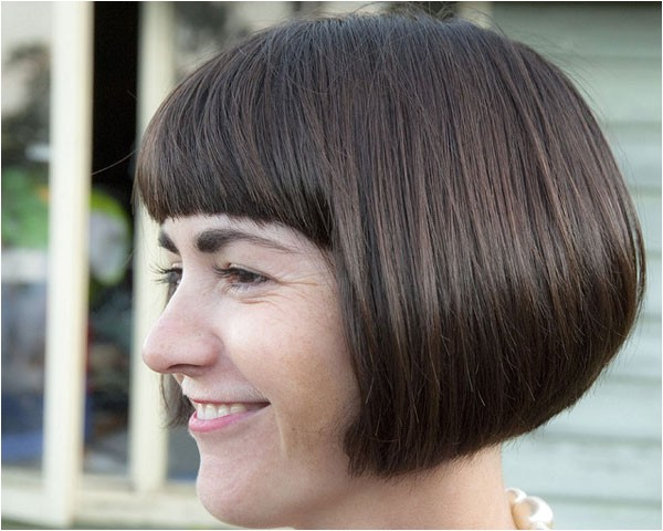 rounded bob hairstyle goes well thick front fringe