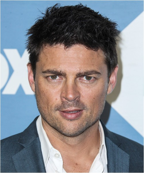 Karl Urban spiked up casual hairstyle