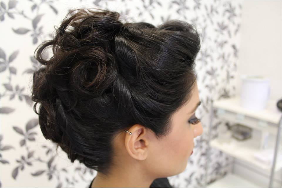 asian bridal hair style with bun braid and back bing style
