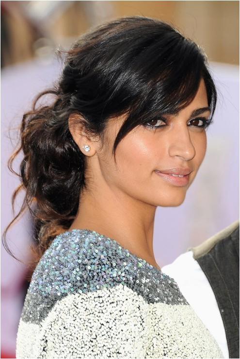 camila alves easy black updo with side swept bangs for long hair