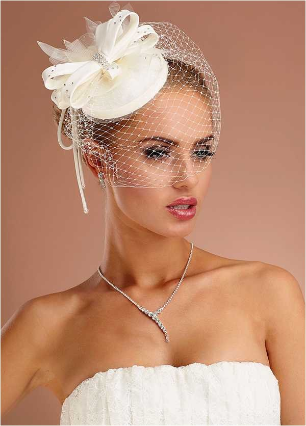 loose wave bob with fascinator tiny top hat