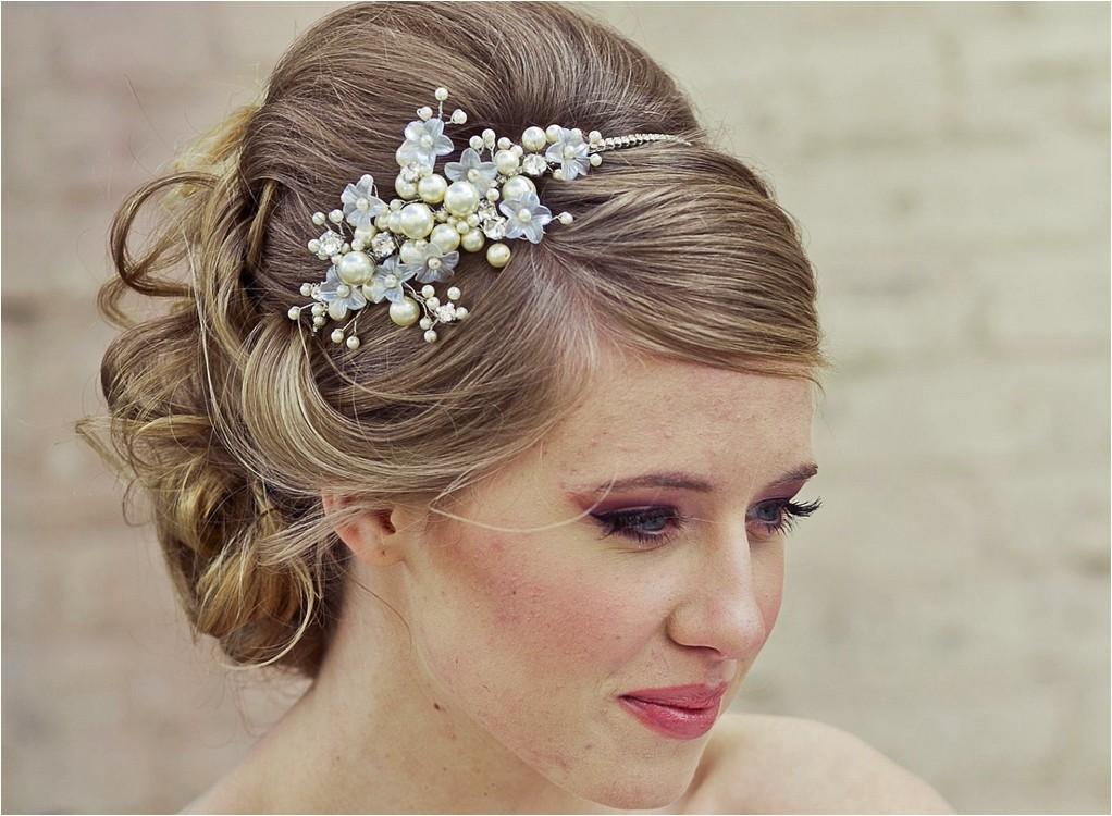 updo hairstyle flowers pearls wedding headb 6