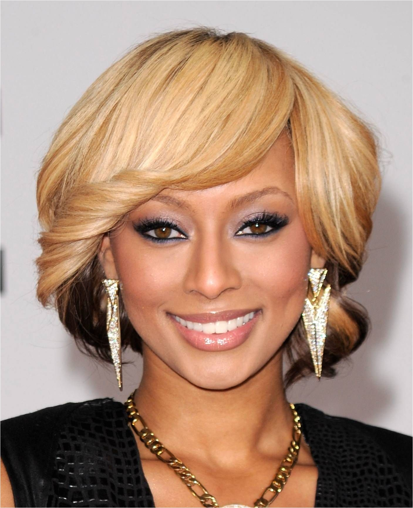hide a wide forehead with wide swept bangs heart shaped faces this do gives the impression of a bob too