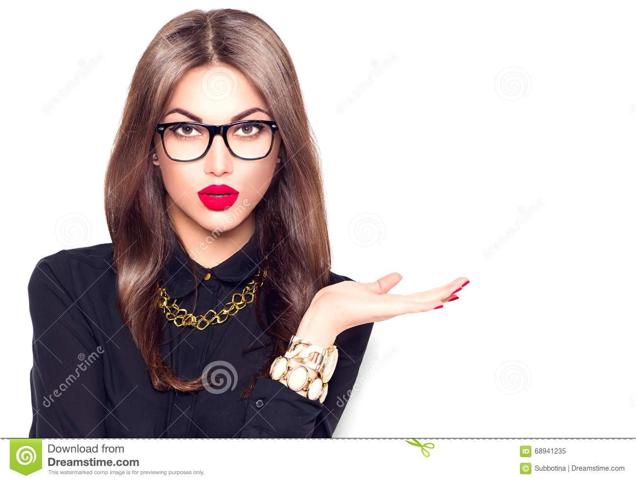 Beauty girl wearing glasses showing empty copyspace