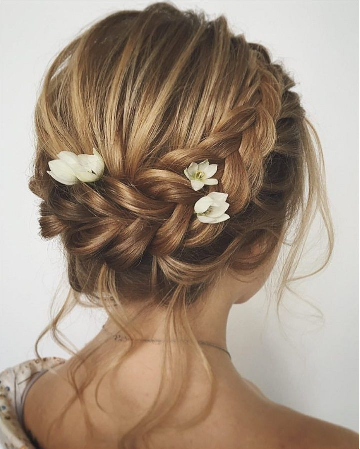 Unique updo with braid wedding hair inspiration