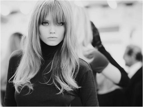 70s style blonde with bangs