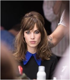 Alexa Chung Half Up Half Down hair 60s style hairstyle heavy bangs sideswept fringe Bangs Hairstyles