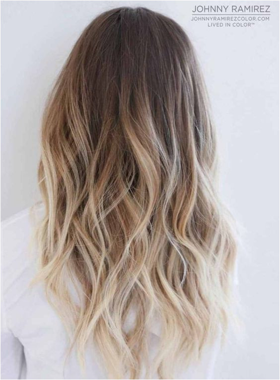 ombre blonde long curly hair hairstyle dark root
