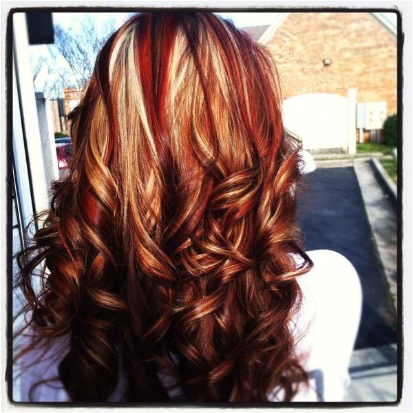 Colors lots of red with blonde underneath and very dark brown or black on the