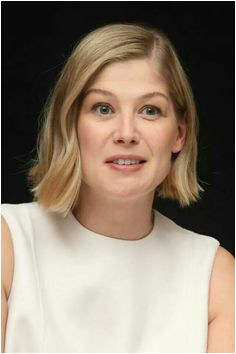 """Rosamund Pike at a press conference for """"Gone Girl"""" Ritz Carlton Hotel"""