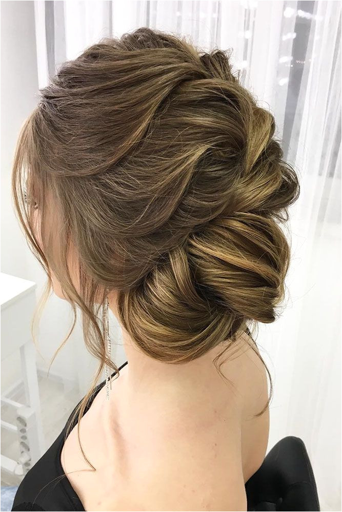 Bridal Hairstyles 30 Eye Catching Wedding Bun Hairstyles wedding bun hairstyles side bun oksan