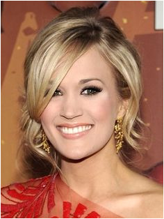 carrie underwood side bun prom updo hairstyle with side bangs