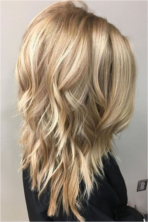 Medium length layered hairstyle contains layered hairstyle for all age group Layers are perfect for face framing and medium hair looks great with layers