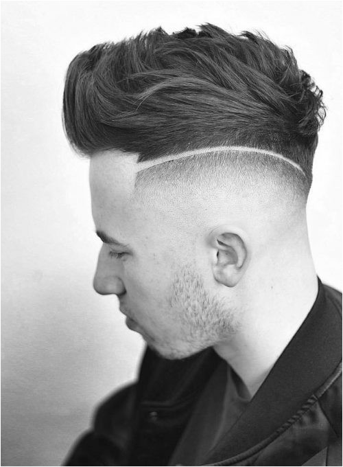 A picture of a mens short fade haircut with a surgical line