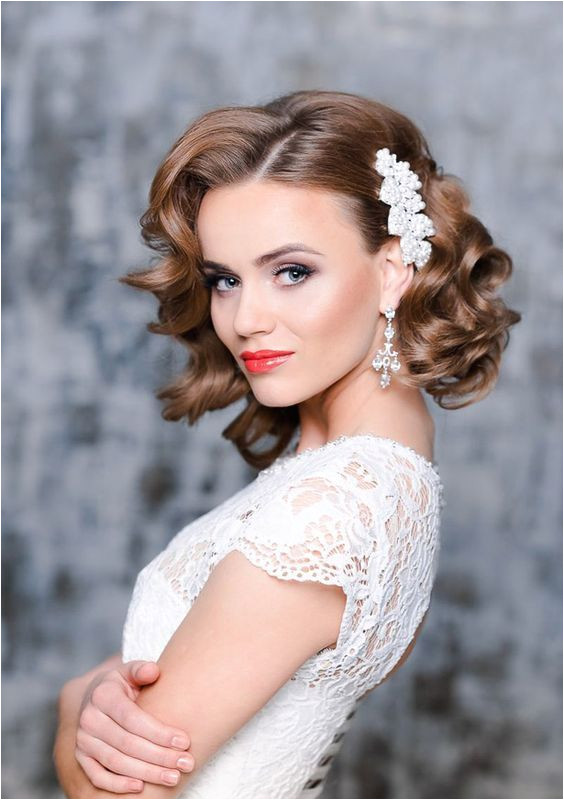 26 Short Wedding Hairstyles And Ways To Accessorize Them short curly bridal hair with a side pearl hairpiece to make a glam and girlish accent bridalhair