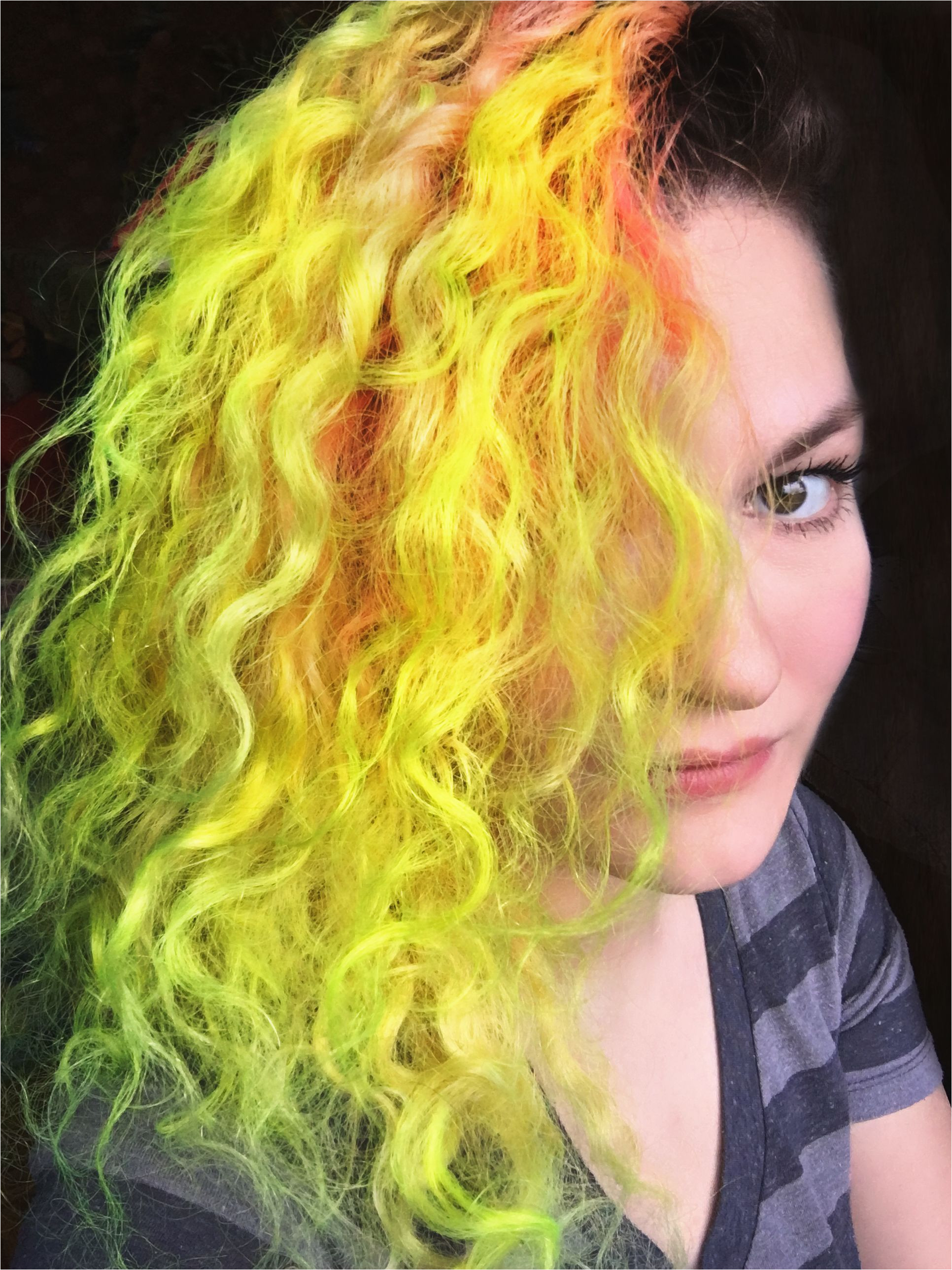 Neon Yellow curly hair with a side shave Dyed with Pravana Vivids