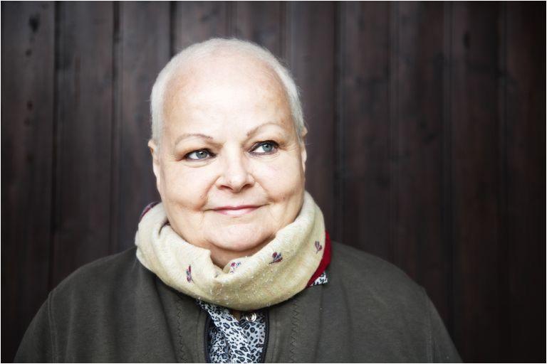 cancer survivor with chemo curls