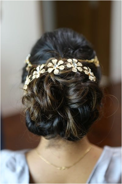 messy bun wavy bun bun with hair accessory engagement hairstyle floral hair…