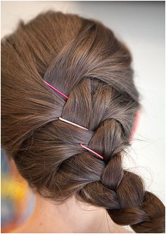 Fix any wispy pieces or bumps with cute colored bobby pins instead of redoing your entire