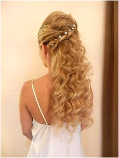 Pretty down style w an assymetric twist Renata Jones · grecian hairstyles
