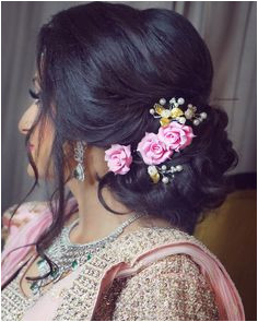 Slay the hair on your engagement pink rose lower bun loose strands Hair Artistry By Archana