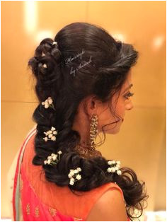 Gorgeous romantic bridal hairstyle for Sangeet Hairstyle by Team Swank Braids with flowers