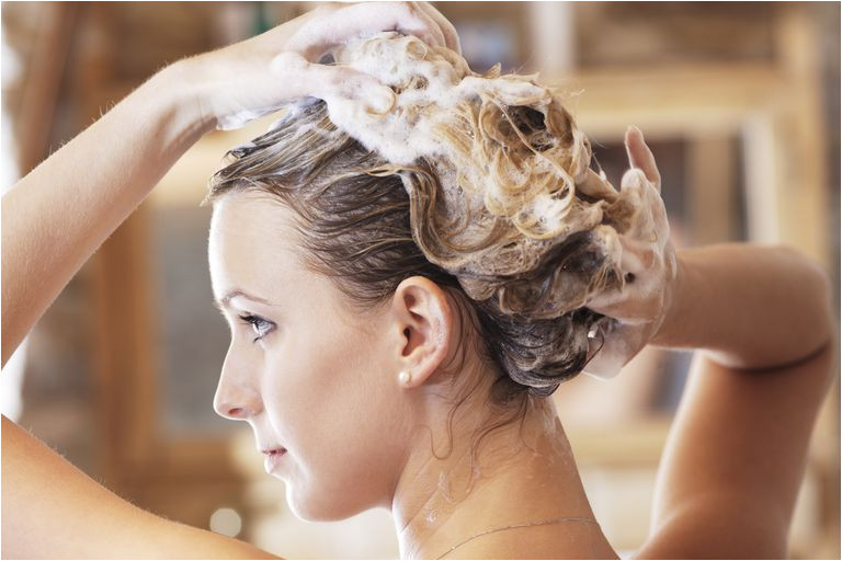 young woman washing hair close up sb p 001 57cf30f43df78c71b68a9bde