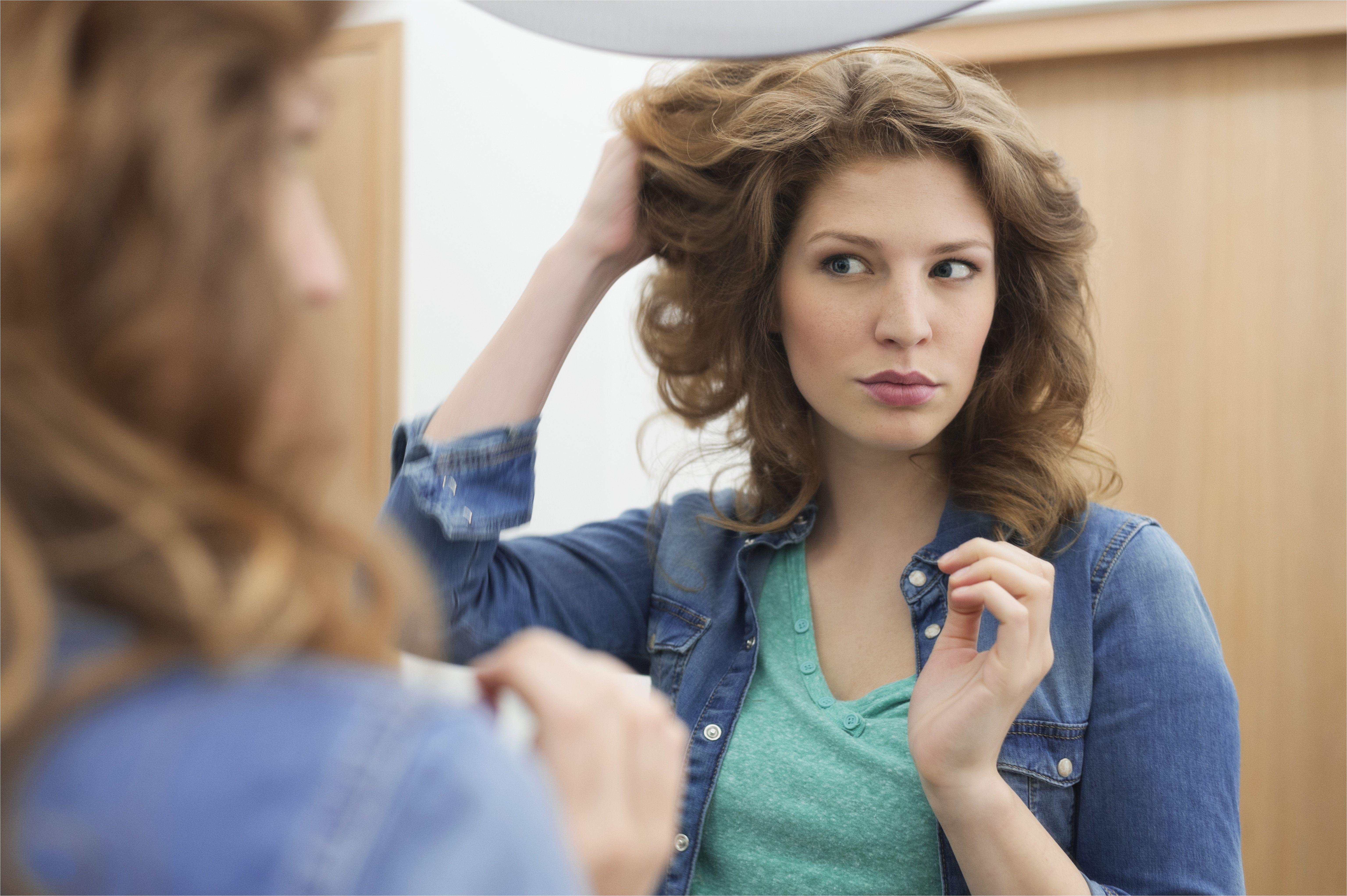 woman examining her hair 57ed3b4b5f9b586c35c8d835