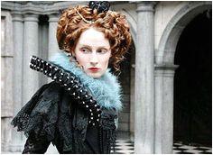 Elizabethan Inspired makeup Porcelain skin red Lips defined cheekbones curled hair Elizabethan