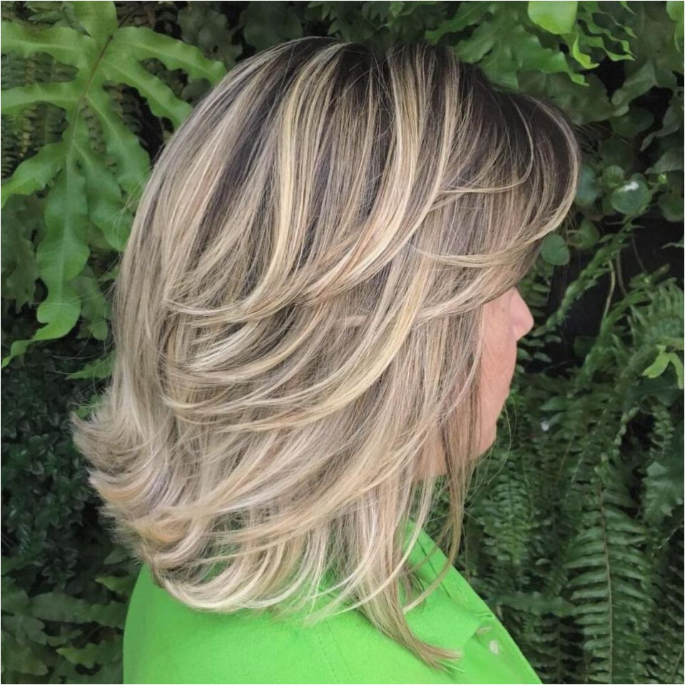 Mid Length Feathered Ash Blonde Hairstyle