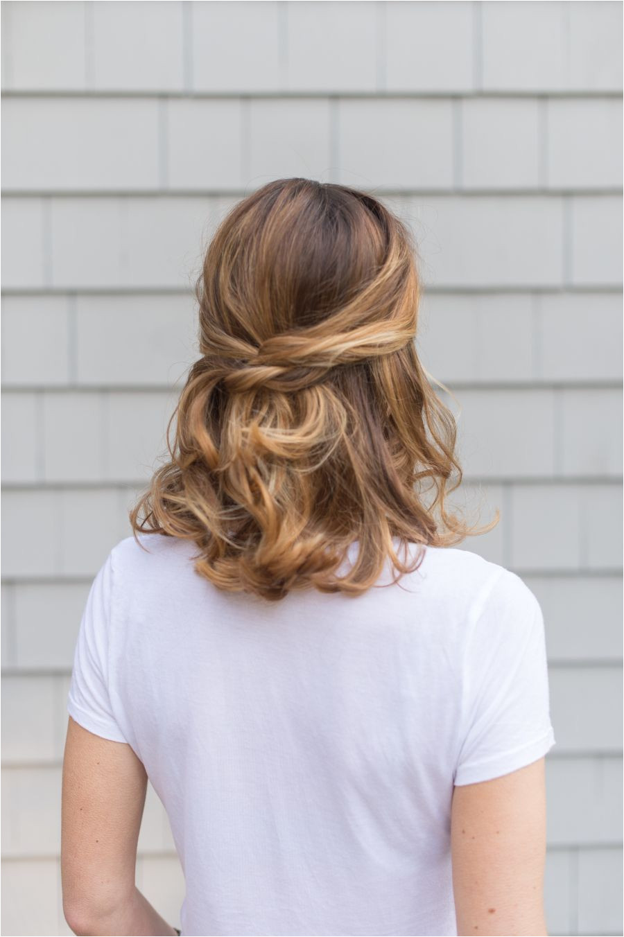With the utility of a ponytail and the soft femininity of having your hair down this half up half down hairstyle is as perfect for every day life as it is
