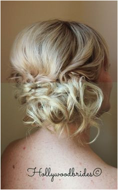 The Blonde hair shows off the texture of this adorable boho wedding hairstyle