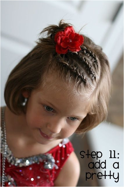 Three dutch braids into a messy bun Cute little girl s hairstyle for short or long hair Good style when growing out bangs