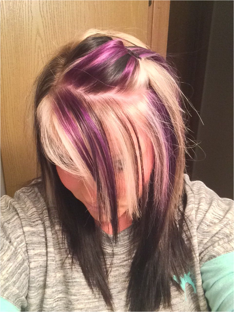 Purple blonde and black on top with all black underneath Black Hair With Red