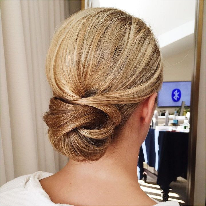 Get inspired by this fabulous simple low bun wedding hairstyle Beautiful wedding hairstyle Get inspired by fabulous wedding hairstyles wedding low updos