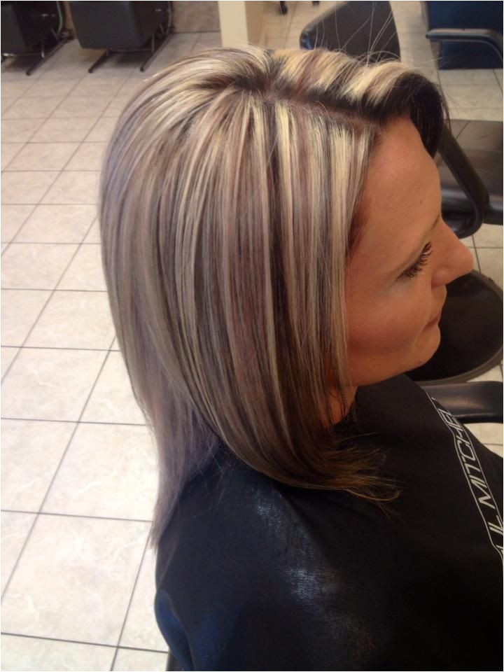 chunky 3 tone highlight and lowlight platinum blonde hair with caramel and black lowlights