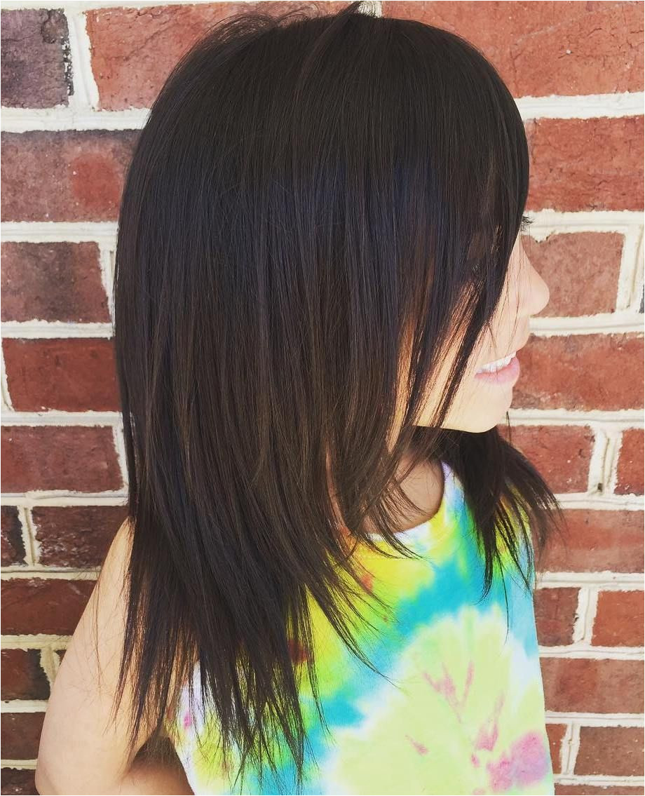Layered Mid Length Haircut For Girls
