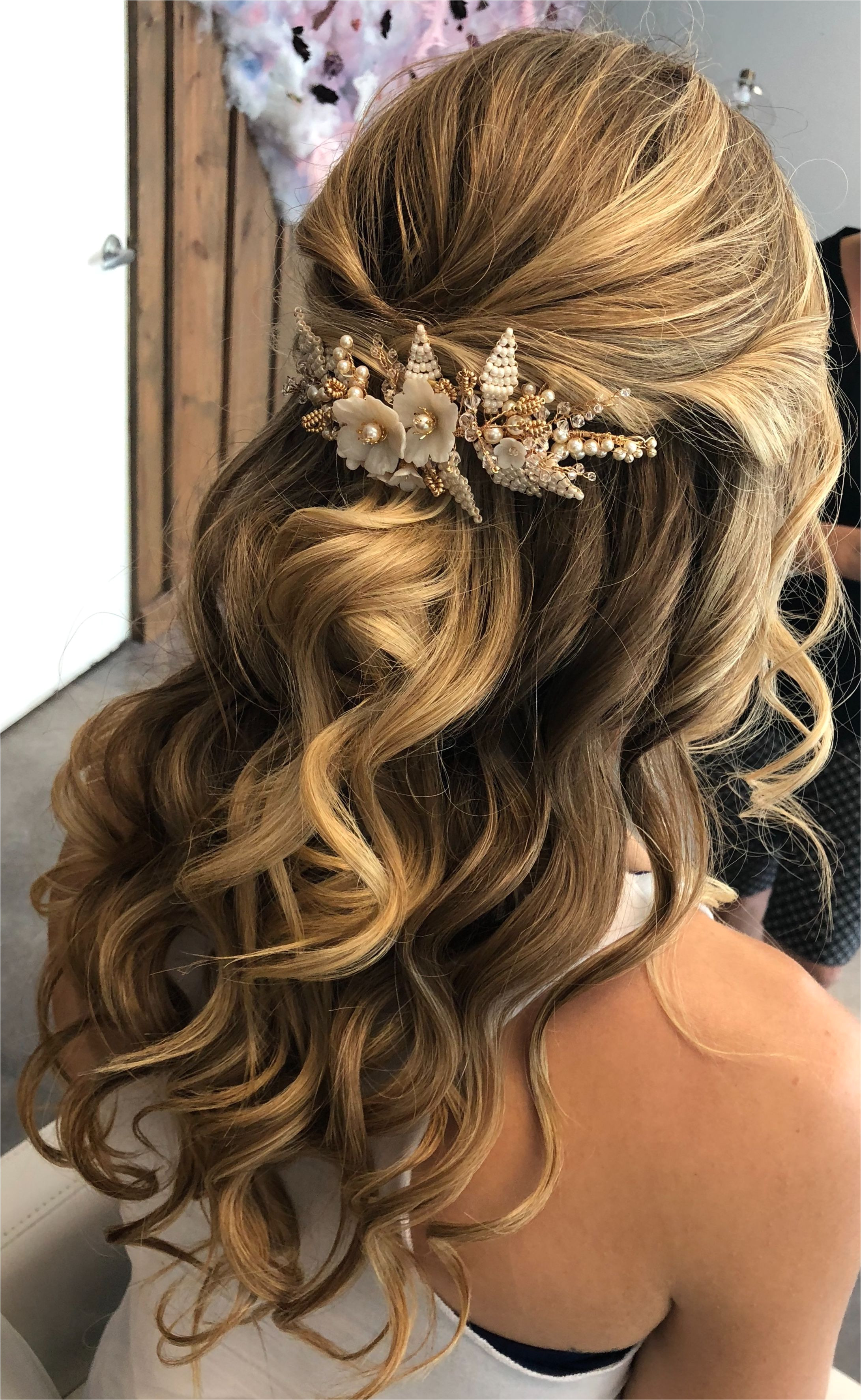 Half up half down bridal hair style with hair accessory from allaboutromance Etsy shop